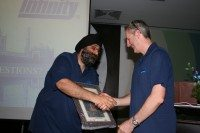 Harjeev Kandhari presents Eamon Daly of Daly Tyres with a gift