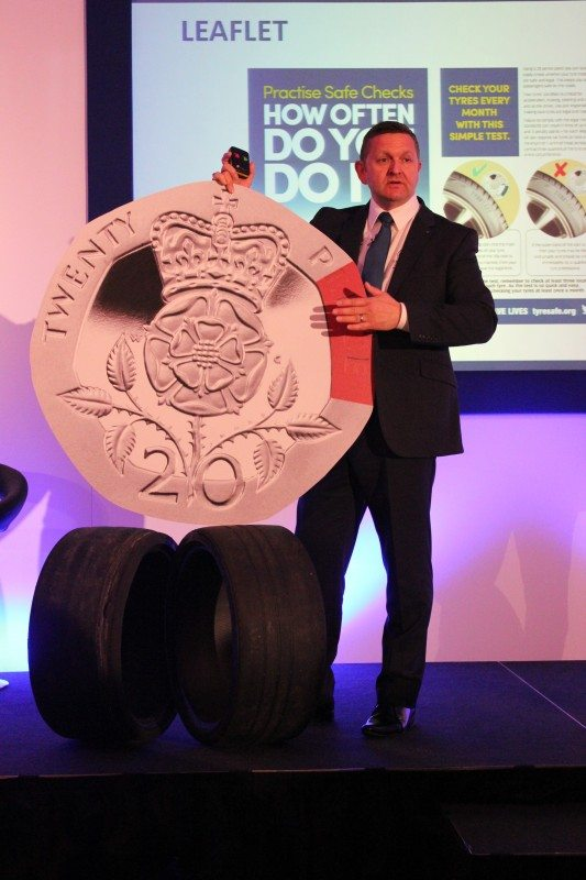 TyreSafe chairman Stuart Jackson demonstrates the simplest method of checking tread depth using an over-sized twenty pence piece