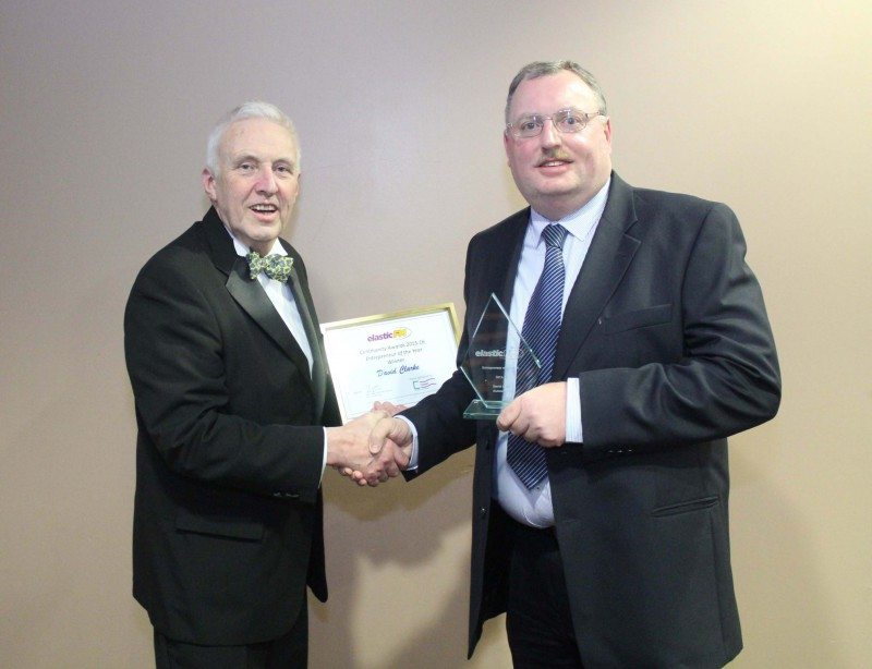 Autosupplies managing director, David Clarke collects his Entrepreneur of the Year award from and Paul Davies