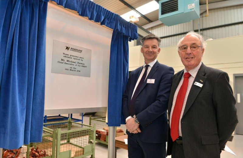 Mike Hawes, chief executive of the UK auto industry organisation SMMT, opens the new CV brake calliper remanufacturing facility at Roadlink International, Strawbeey Lane, Willenhall. He is joined by Roadlink Chairman, David Sedgley
