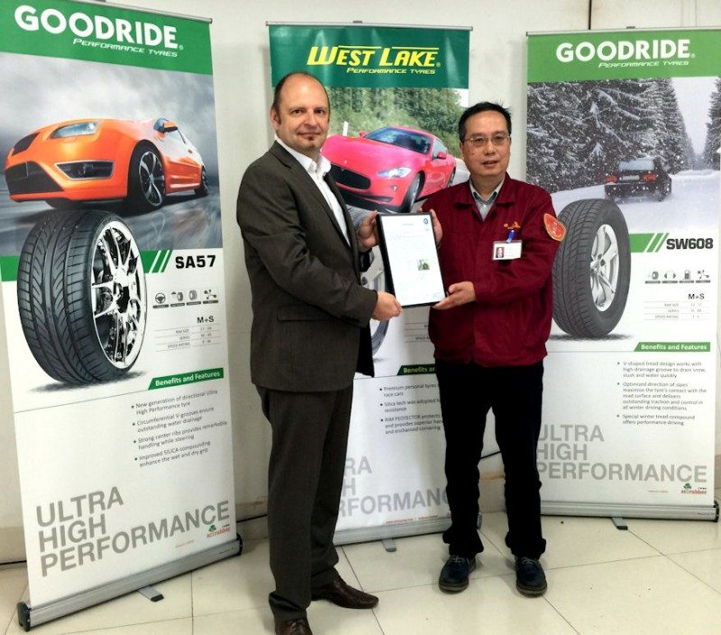 Michael Staude, general manager tyres and wheels at TÜV SÜD, presents the certification to Zhang Limin, vice-president of production at ZC Rubber