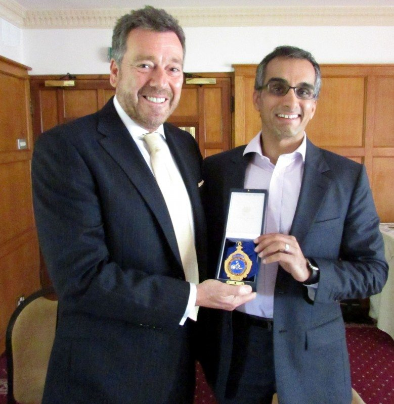 Roger Griggs, NTDA National chairman, presents Prashant Chopra with his vice chairman's Badge of Office