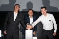 (l to r) Lothar Salokat, Nikolai Setzer and Georg Reichert push the button to officially bring the HPTC into operation