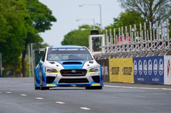 Mark Higgins helped Dunlop and Subaru set a new four-wheel record on the Isle of Man TT Mountain Course