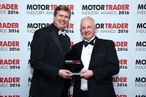 Graham Clark receives the award