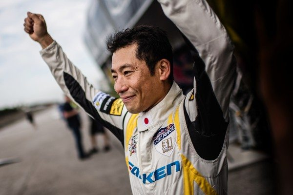 Yoshihide Muroya of Japan arrives after he won the finals of the third stage of the Red Bull Air Race World Championship in Chiba, Japan on June 5, 2016