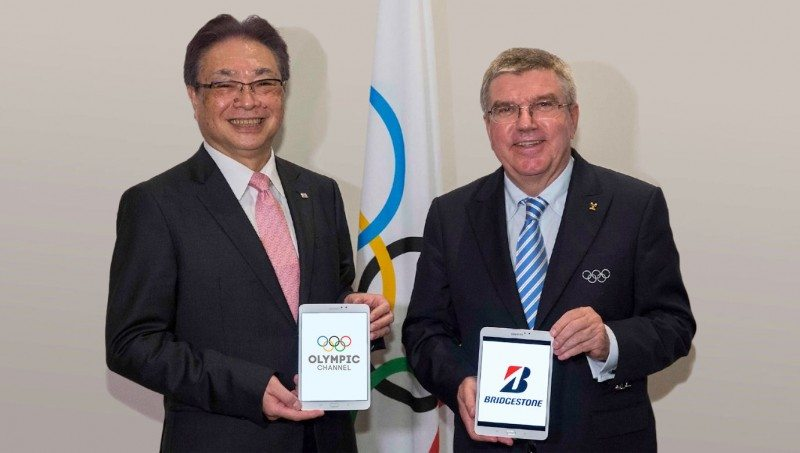 Masaaki Tsuya (l) and Thomas Bach celebrate Bridgestone's partnership with the Olympic Channel
