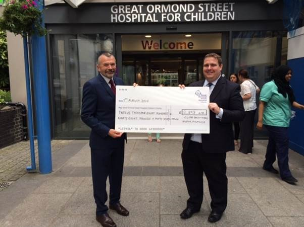 John Murphy, account manager Sheffield branch and Mark Dowson, finance director at Close Brothers Motor Finance presenting Great Ormond Street with the cheque