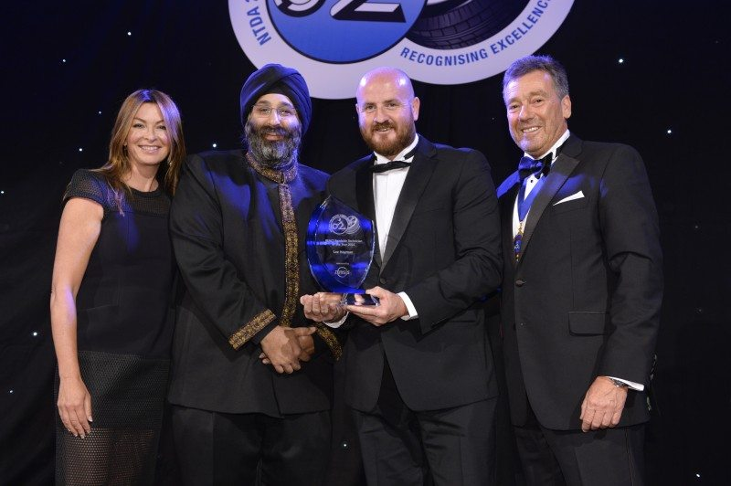 (l-r) Guest speaker Suzi Perry; Harjeev Kandhari (Zenises); REACT Roadside Technician of the Year Lee Hayman (ATS Euromaster); and Roger Griggs (NTDA)