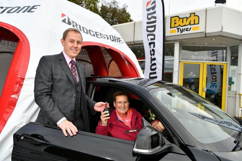 Jane Robinson receives the key to her new BMW from Bush Tyres' Ben Bush