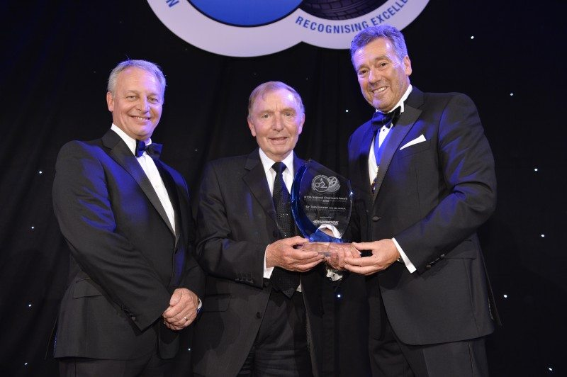 Hankook's Brett Emerson (left) and NTDA chairman Roger Griggs (right) presented the chairman's award for outstanding contribution to the Tyre Industry to Sir Tom Farmer (centre)