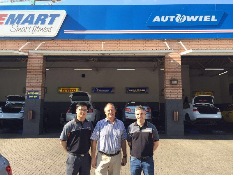 (l-r) Wilson Zhang, Davanti vice general manager, Paul Bosman, chairman & managing director of Autowiel, member of the Tyremart Network; and Peter Cross, Davanti general manager, outside Autowiel's Pretoria centre