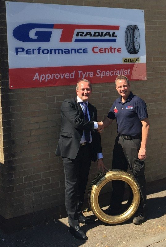 Brian McDermott, Giti Tire sales and marketing director – Europe for passenger car and light truck (PCR) presents Perry Adams of Perry's Tyres & Exhausts Service with the Golden Tyre, marking the 500,000th GT Radial FE1 to be sold in Europe since its launch