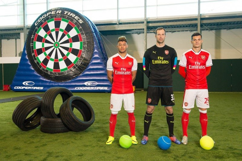 Cooper's football darts competitors were (l-r) Arsenal winger Alex Oxlade-Chamberlain, goalkeeper Petr Čech, and midfielder Granit Xhaka