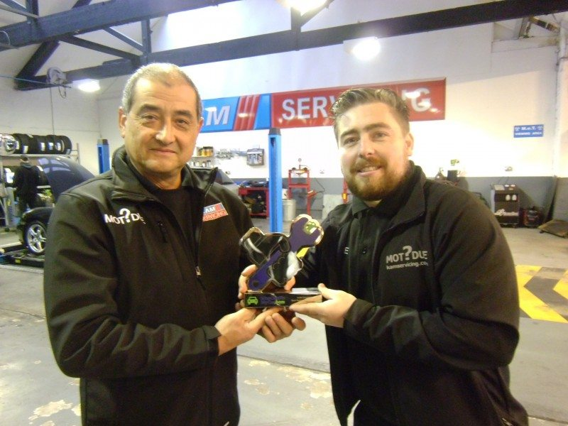 KAM Servicing's depot manager Shaun Huxley-Dugan (left) and sales advisor Ashley Brown celebrate winning a WhoCanFixMyCar.com award