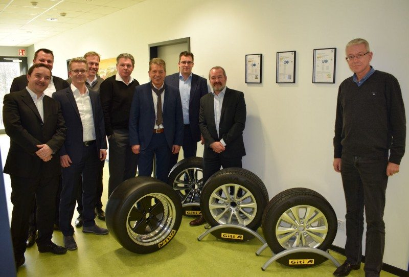 Some of the team behind the development and rollout of Giti's European range pose with the new products and Giti race tyres: (l to r) Fabio Pecci-Boriani, Tobias Stöckmann, Dr Claus Oberbeck, Martin Wells, Stefan Fischer, Reimund Wolfmüller, Stefan Brohs, Brian McDermott and Matthias Hartwig