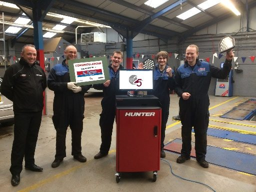 Staff at K Brown Auto Repairs in Kings Lynn celebrate their £15,000 alignment prize win