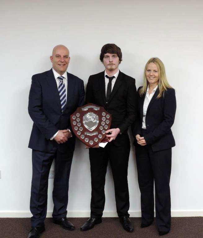 Bob Ackroyd and Maureen Cole present Autosupplies Employee of the Year award 2017 to Tyler Clarke (centre)