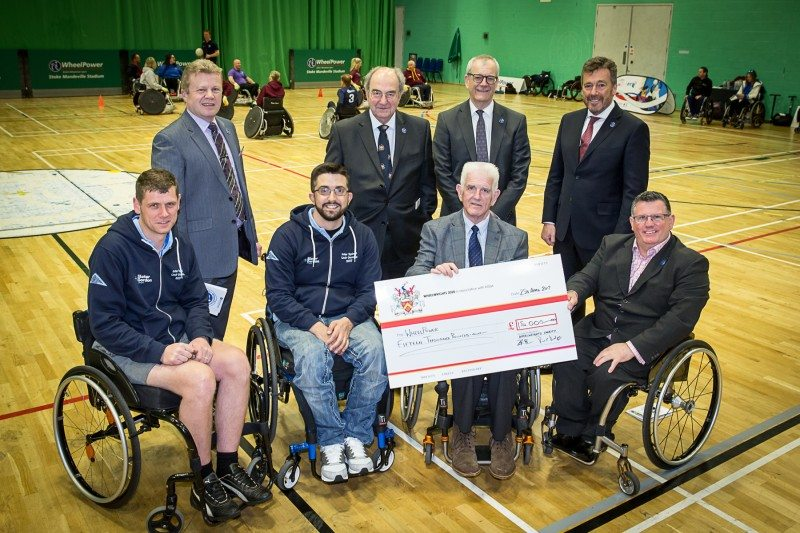 NTDA national chairman Roger Griggs and chief executive Stefan Hay at the Wheelpower Cheque presentation