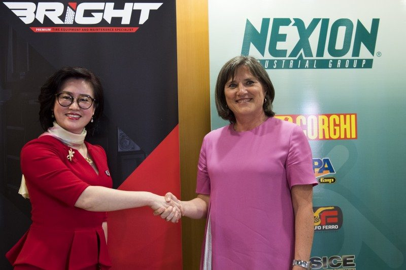 Bright's Mary Wei and Nexion's Cinzia Corghi shake on the deal