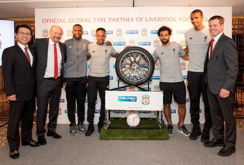 (l-r) Sumitomo Rubber Industries' director and senior executive officer Satoru Yamamoto, Liverpool FC's CEO Peter Moore, Daniel Sturridge, Nathaniel Clyne, Mohamed Salah, Joël Matip & Billy Hogan, Liverpool FC's chief commercial officer and managing director celebrate the new partnership