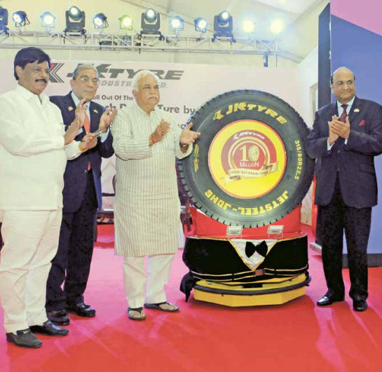 "Dr Raghupati Singhania, seen here at the right during celebrations marking the company's 10 millionth TBR tyre last year, says India's government must ""undertake necessary steps"" to impose anti-dumping duties"