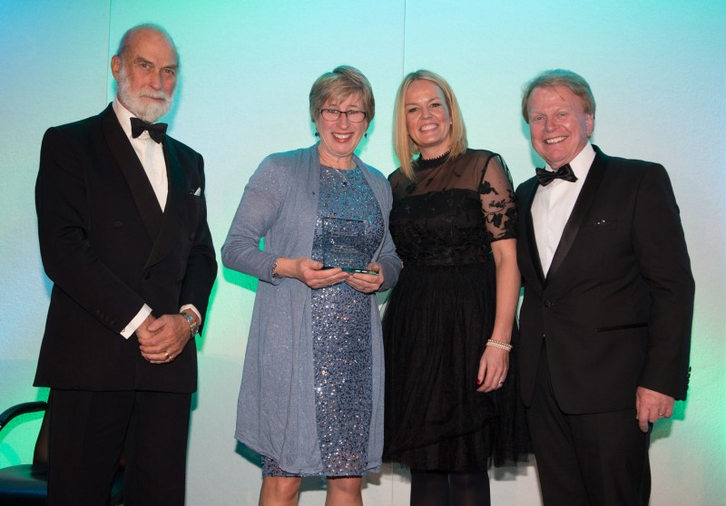 Kathryn Beaurain (centre-left), marketing director of Pro-Align receives the award for her contribution to the work of the IMI, having supported the industry's Skill Auto competitions for the last six years