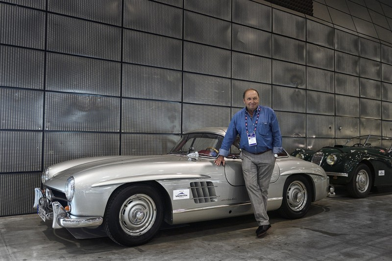 Jochen Mass and the Mercedes 300 SL Gullwing he's driving in this year's Mille Miglia