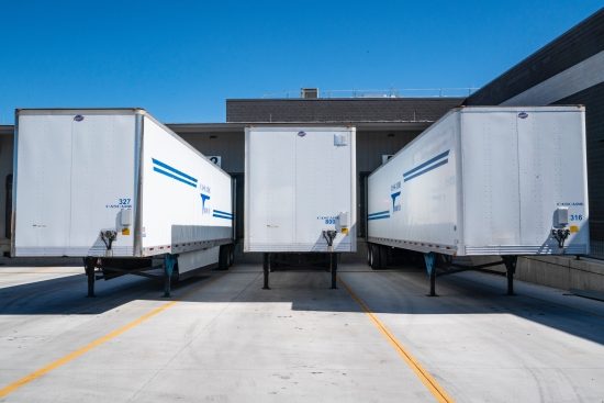 Three white commercial vehicle trailers